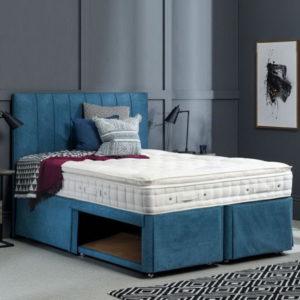 голубая мягкая кровать с ящиками