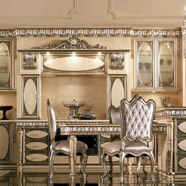 Овальная кухня с патинированными фасадами серая